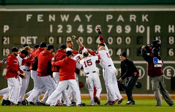 The Boston Red Sox celebrate after defeating the