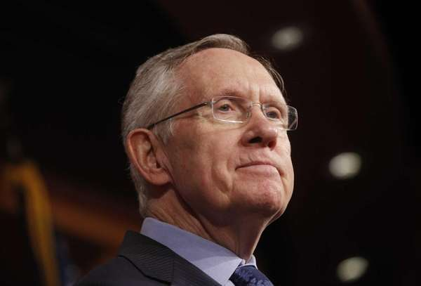 Senate Majority Leader Harry Reid of Nevada, listens