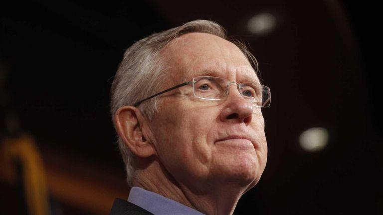 Senate Majority Leader Harry Reid of Nevada, listens