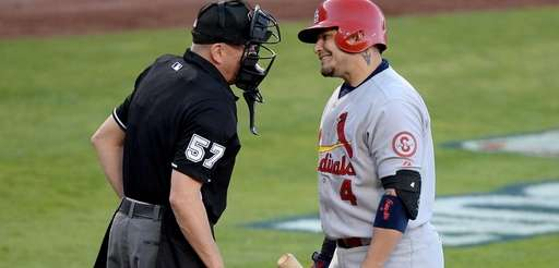 St. Louis Cardinals catcher Yadier Molina argues a