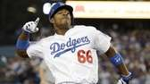 Los Angeles Dodgers outfielder Yasiel Puig reacts after