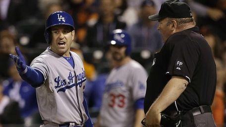 The Los Angeles Dodgers' Nick Punto, left, argues