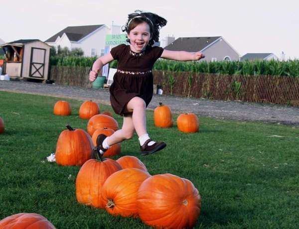 Erin Haggerty, 5, jumps for joy while picking