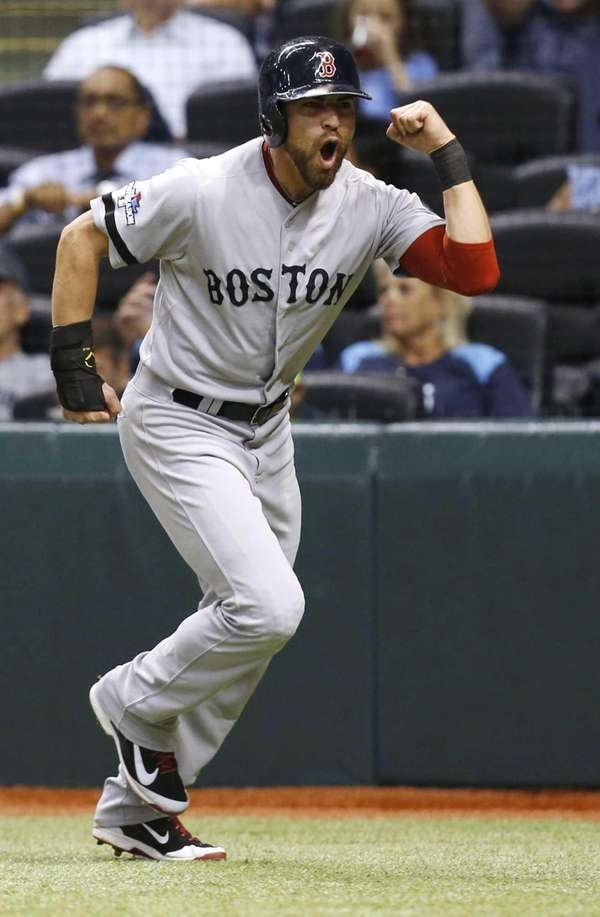 Boston Red Sox's Jacoby Ellsbury celebrates after scoring