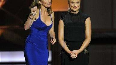 Tina Fey, left, and Amy Poehler present the