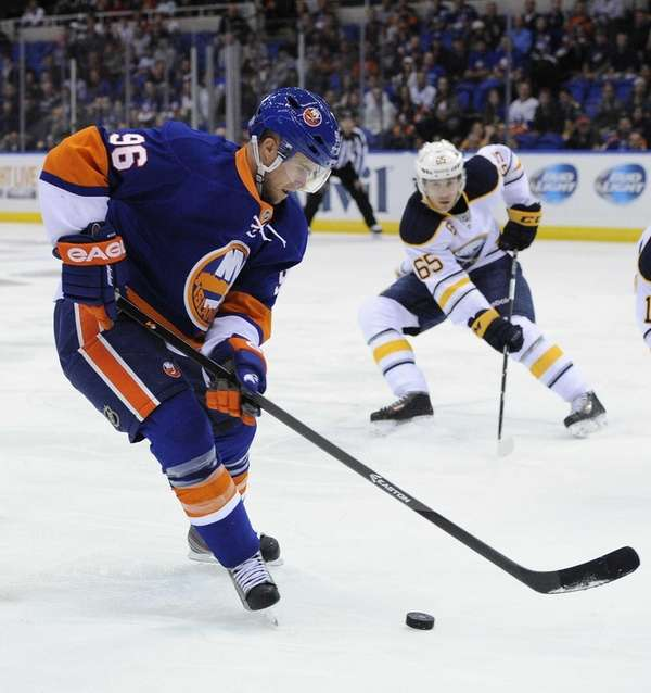 Islanders' Pierre-Marc Bouchard skates against the Buffalo Sabres