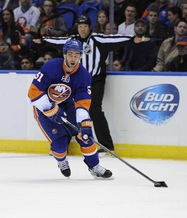 Islanders' Frans Nielsen sets up his shot against