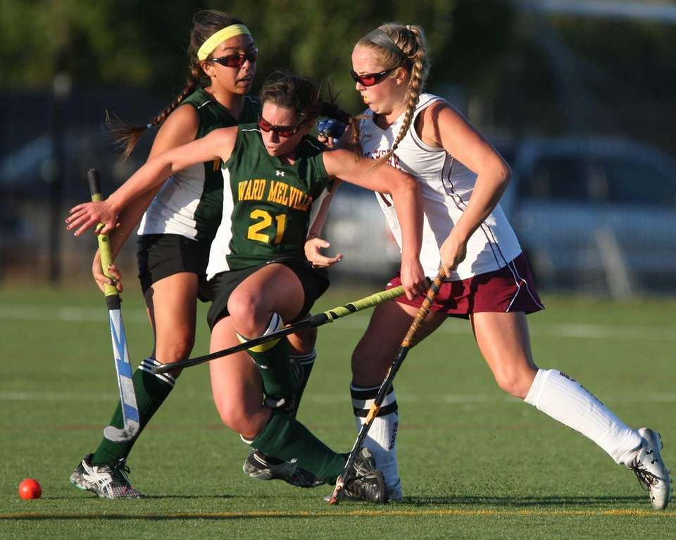 Ward Melville's Katie Koester gets tripped up while