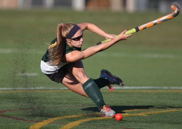Ward Melville's Kelsey Catalano takes a shot against