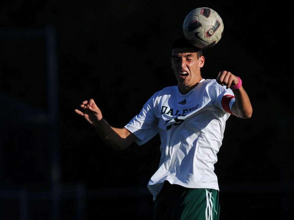 Farmingdale's Joe De Stefano makes a header during
