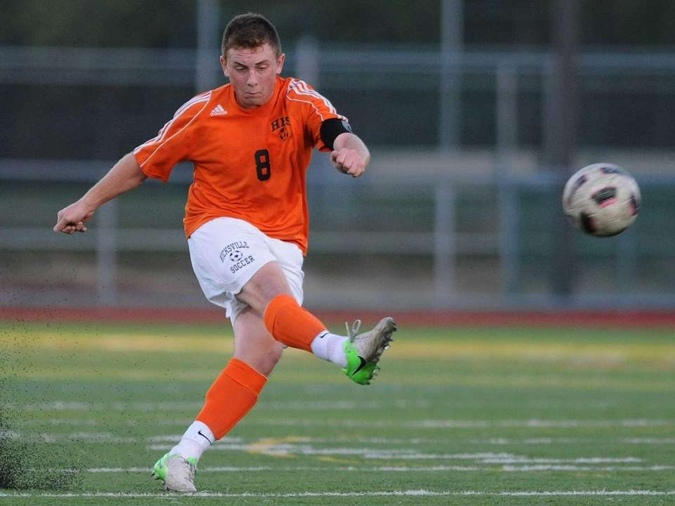 Hicksville's TJ Kilmetis kicks downfield during the second