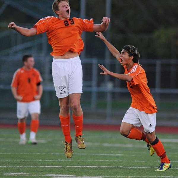 Hicksville's Ryan Dilorenzo, left, and Branden Mueza celebrate