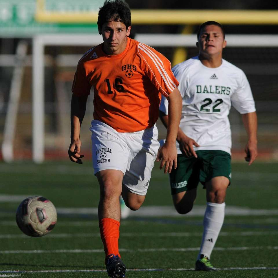 Hicksville's Andrew Purcell, left, pursues a loose ball