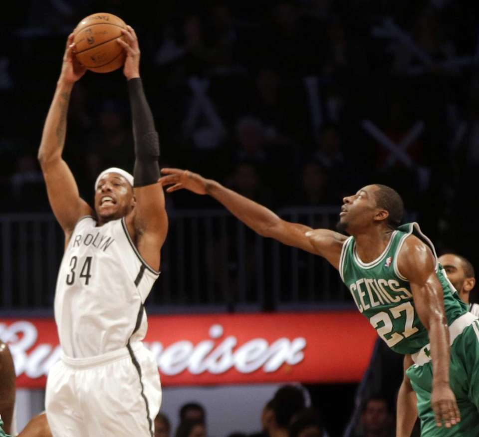 Nets forward Paul Pierce grabs a rebound in