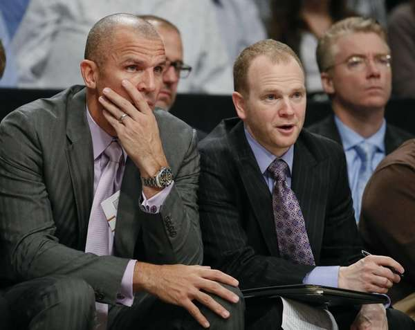 Nets assistant coach Lawrence Frank, right, talks with