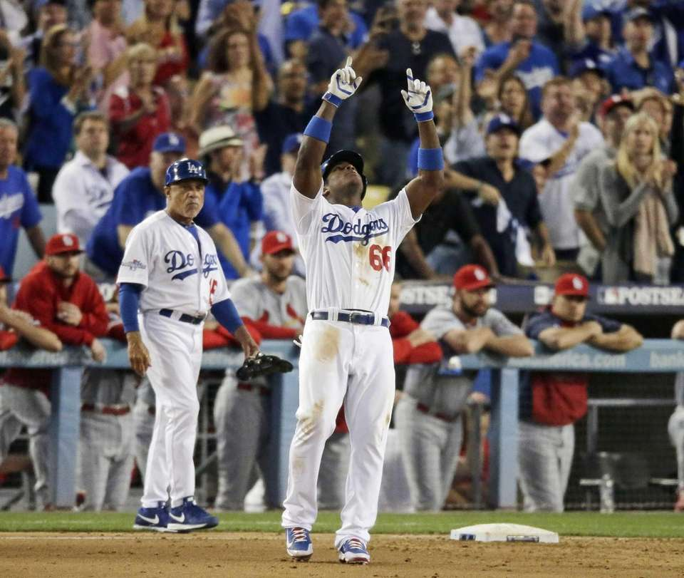 Los Angeles Dodgers' Yasiel Puig celebrates after hitting