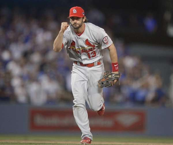 St. Louis Cardinals' Matt Carpenter reacts after turning