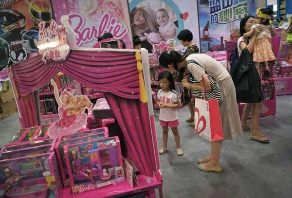 Women with their children visit Barbie toys on