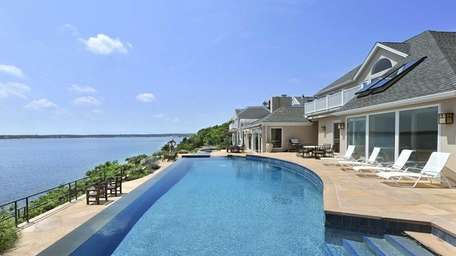 This 11,000-square-foot mansion overlooking the Shinnecock Bay boasts