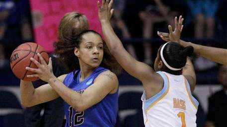 DePaul guard Brittany Hrynko looks to a pass