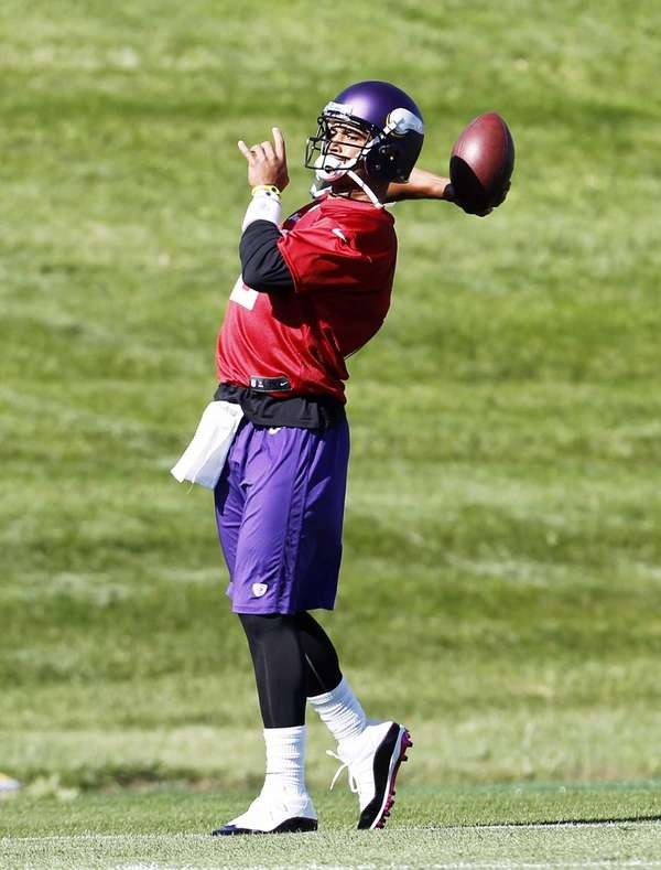 Minnesota Vikings quarterback Josh Freeman throws a pass