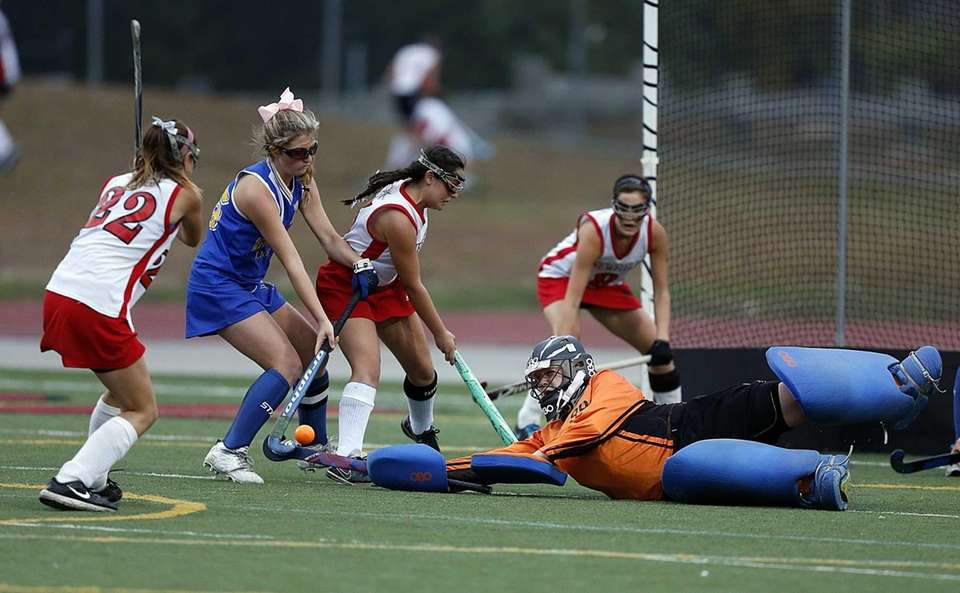 West Islip's goalie Olivia Kelly lays out to