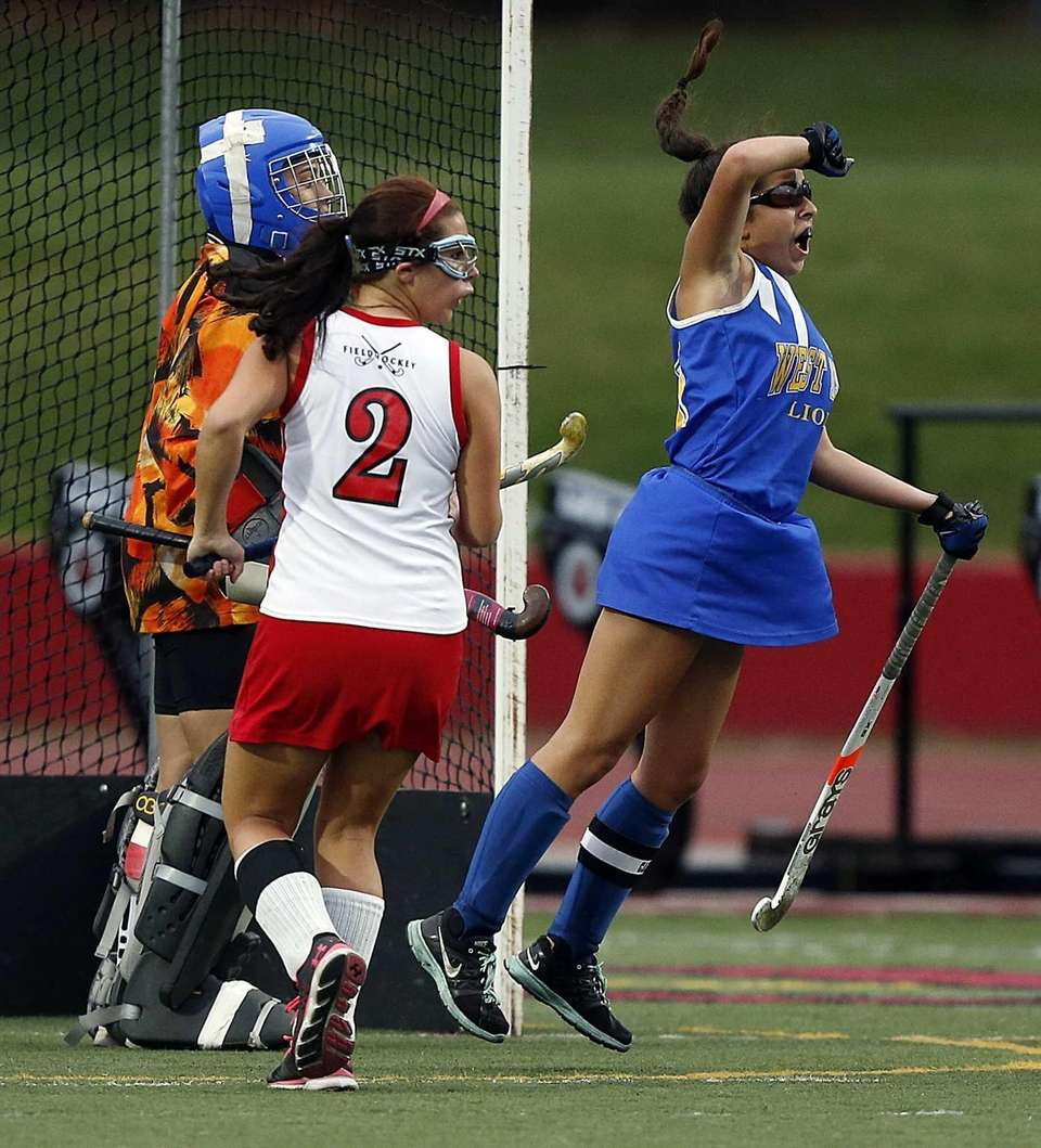 West Islip's Justine DeLuca reacts after the winning