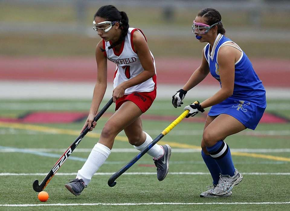 Newfield's Brianna Keyes drives against West Islip's Martina