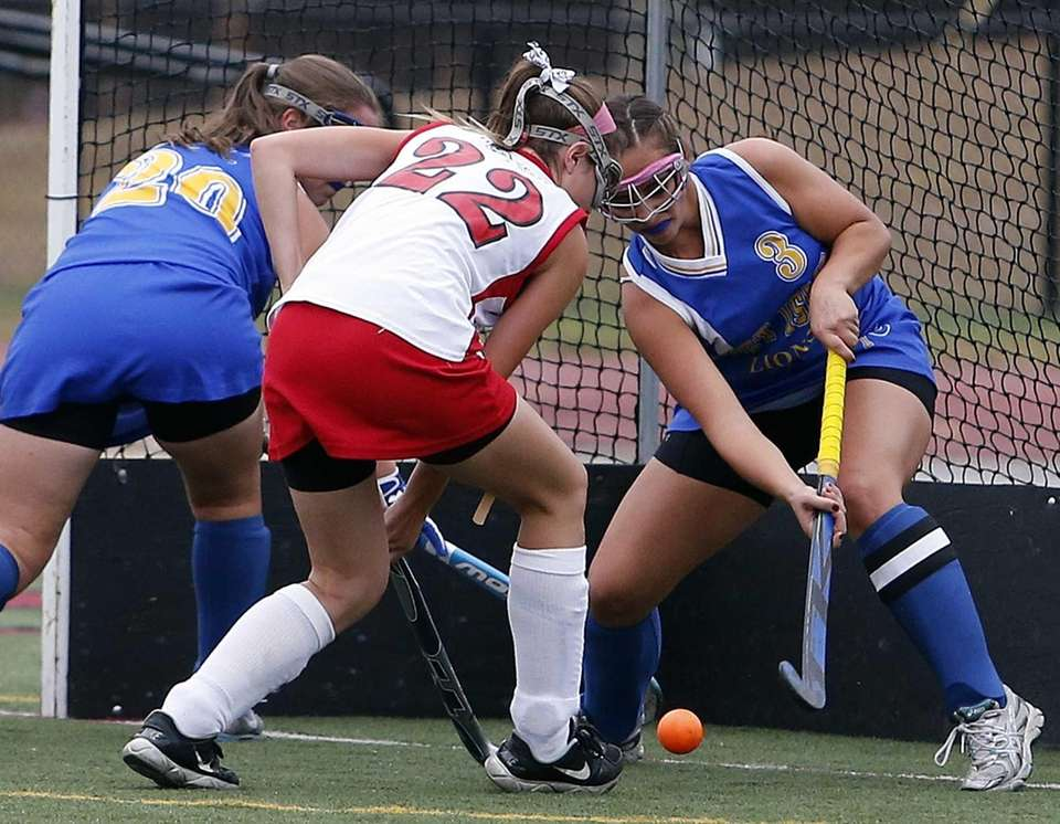West Islip's Martina Tinnirello slaps away the ball