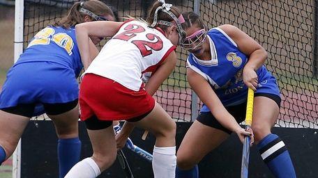 West Islip's Martina Tinnirello slaps away the ball