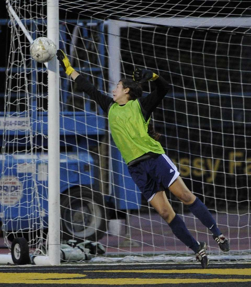 St. John the Baptist goalkeeper Colleen Hickey defends