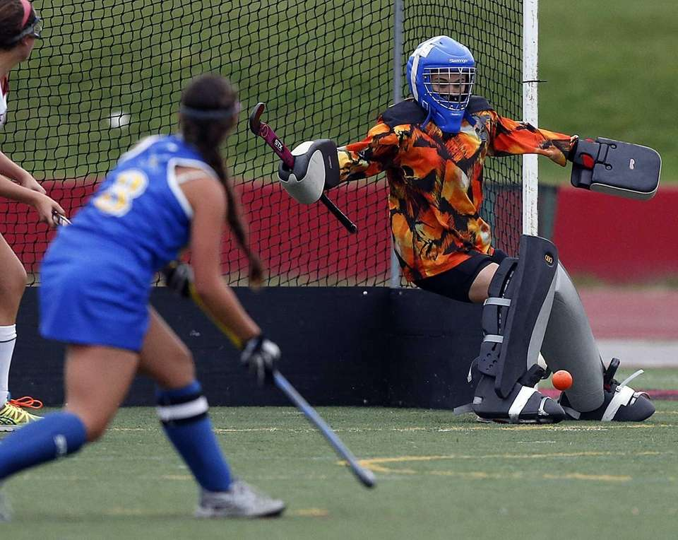 Newfield goalie Maria Daume makes the save on