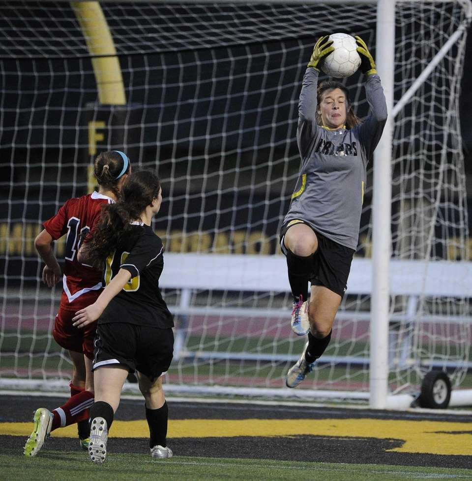 St. Anthony's goalkeeper Kelly DiGregorio leaps to make