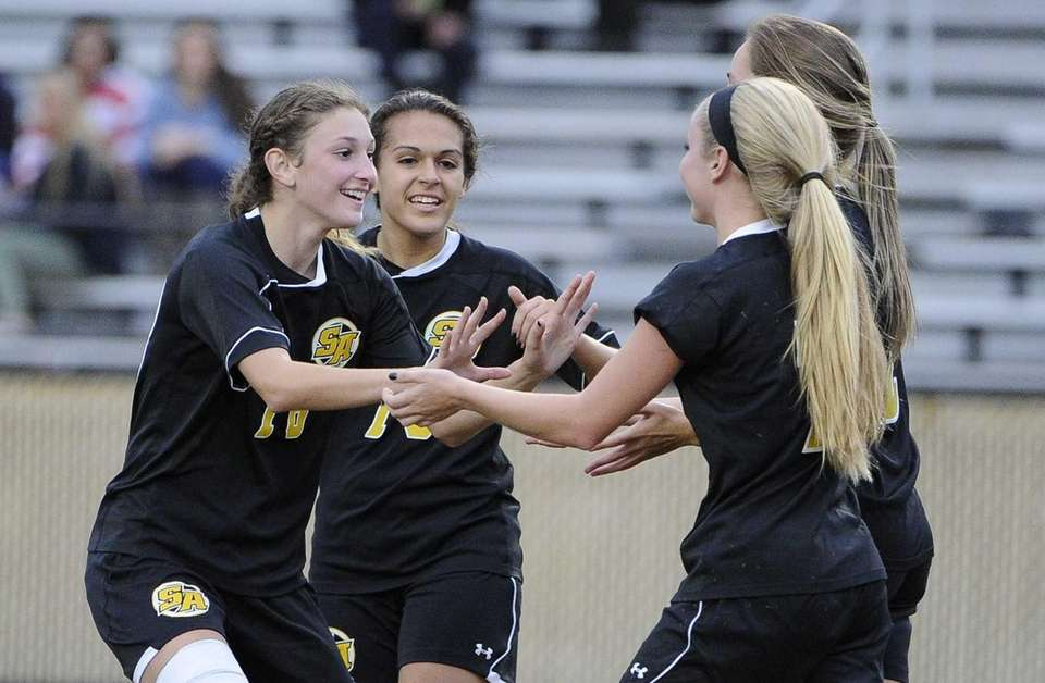 St. Anthony's Chelsea Steigman and Michelle Santangelo congratulate