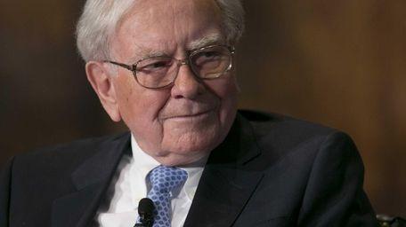 Warren Buffett, above, believes JPMorgan CEO Jamie Dimon