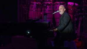 Billy Joel and his band take the stage