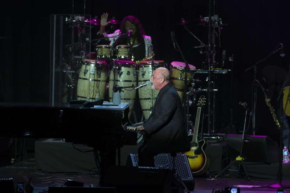 Billy Joel and his band perform at the