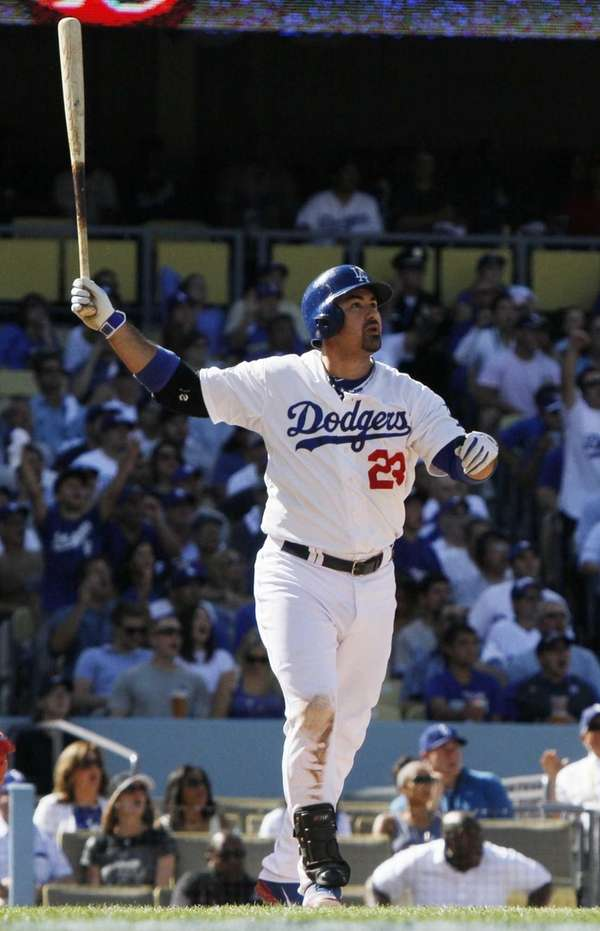 Los Angeles Dodgers' Adrian Gonzalez watches his solo
