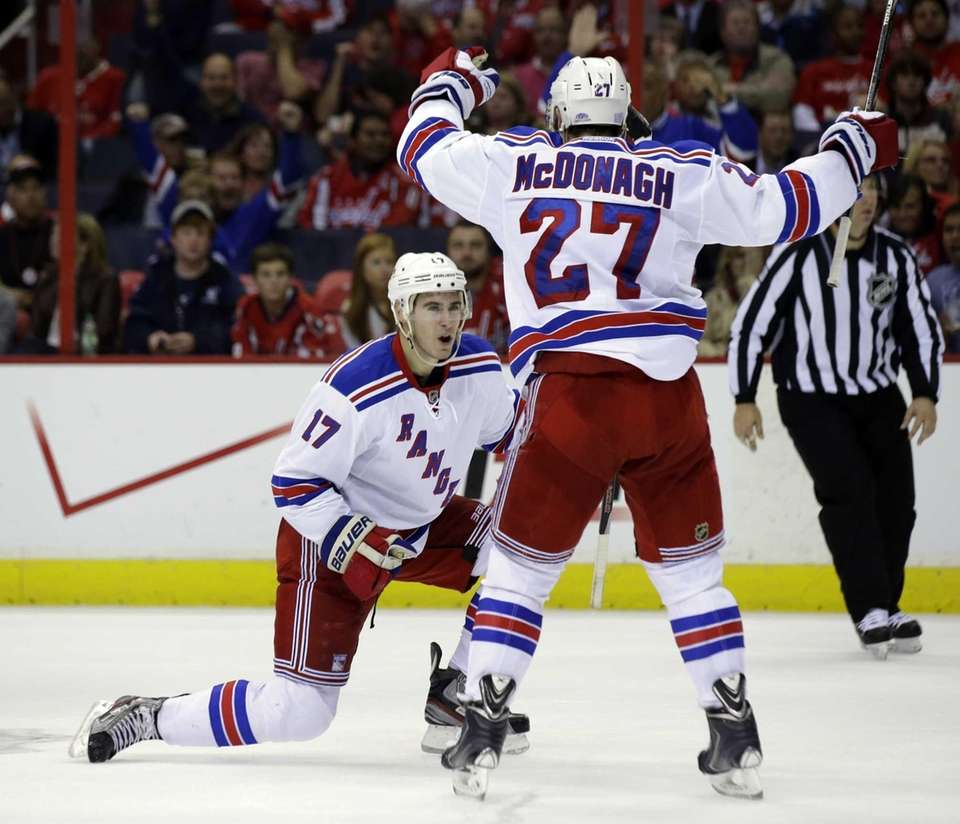 Rangers defenseman John Moore celebrates his goal with