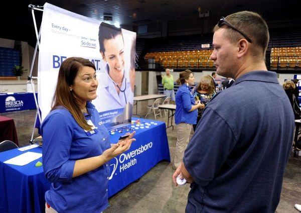 Registered nurse Salanda Bowman, left, talks with part-time