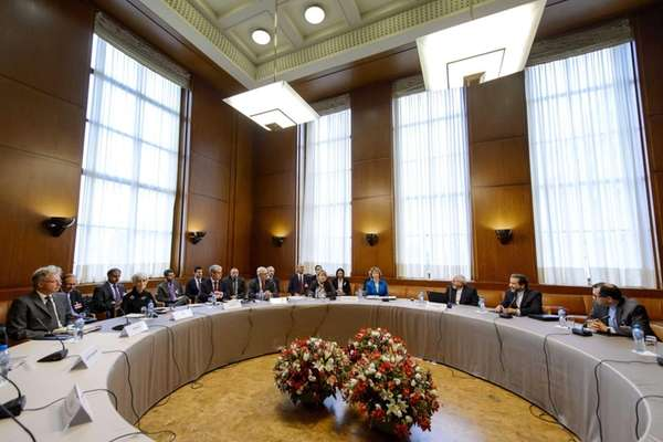 Iran's and world powers' delegations sit prior the