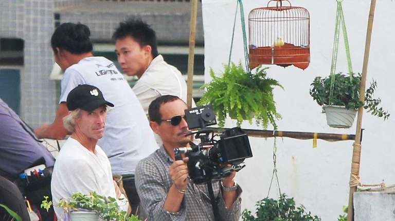 Michael Bay, left, assists the cameraman as they