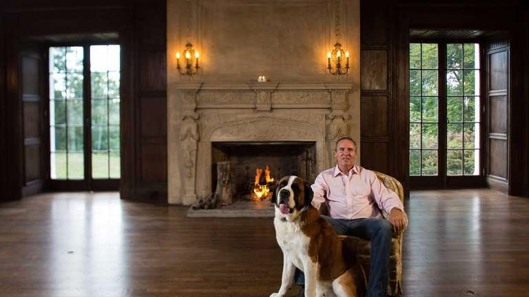 John Schmid, with his dog, Chevy, inside the