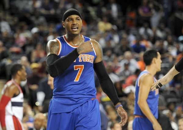 Knicks forward Carmelo Anthony reacts during the first