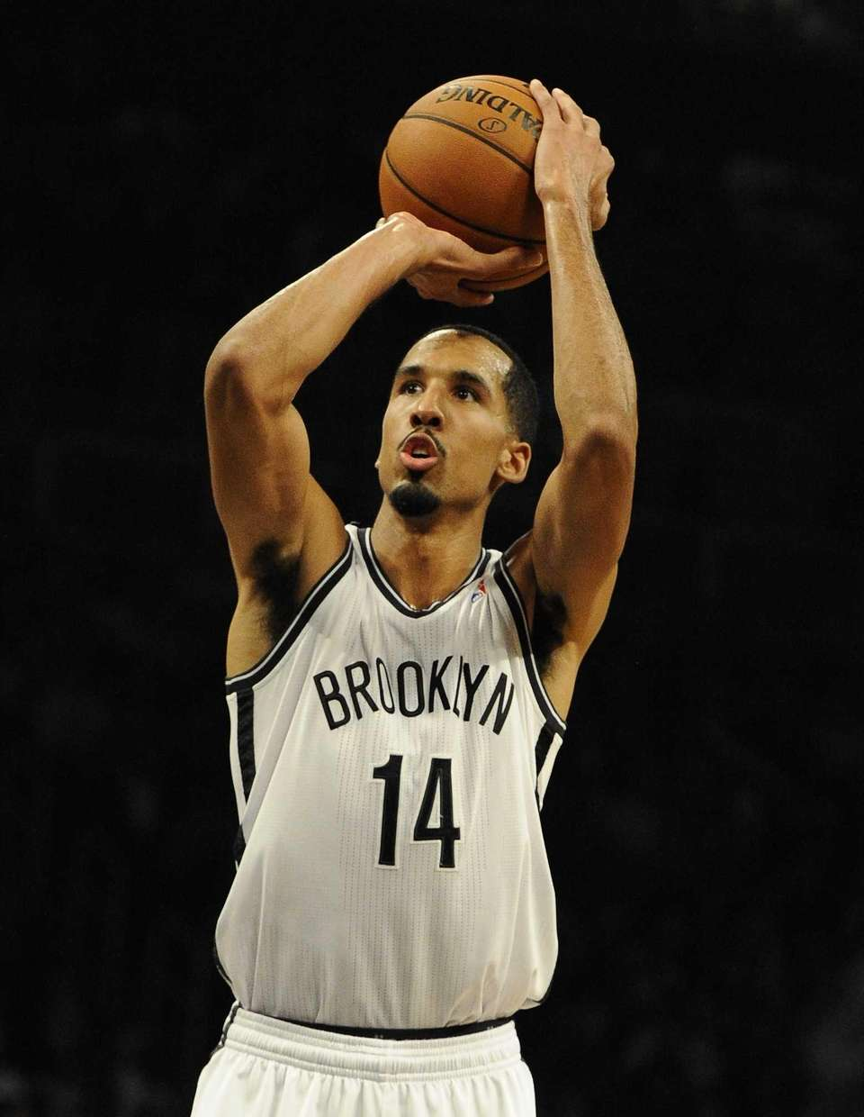 Nets' Shaun Livingston shoots a free throw against