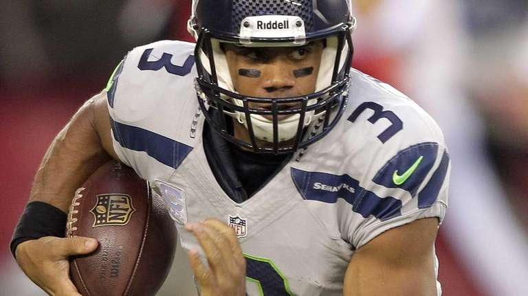 Seattle Seahawks quarterback Russell Wilson runs against the