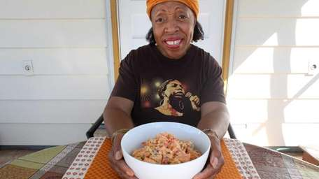 Roslyn Dudley, with her sweet potato salad, cooks