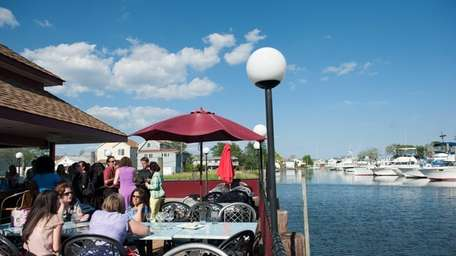 Wildfish in Freeport offers outdoor seating overlooking boats
