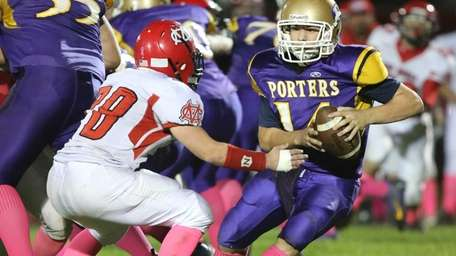 Greenport/Southold/Mattituck quarterback Matt Drinkwater keeps the ball on