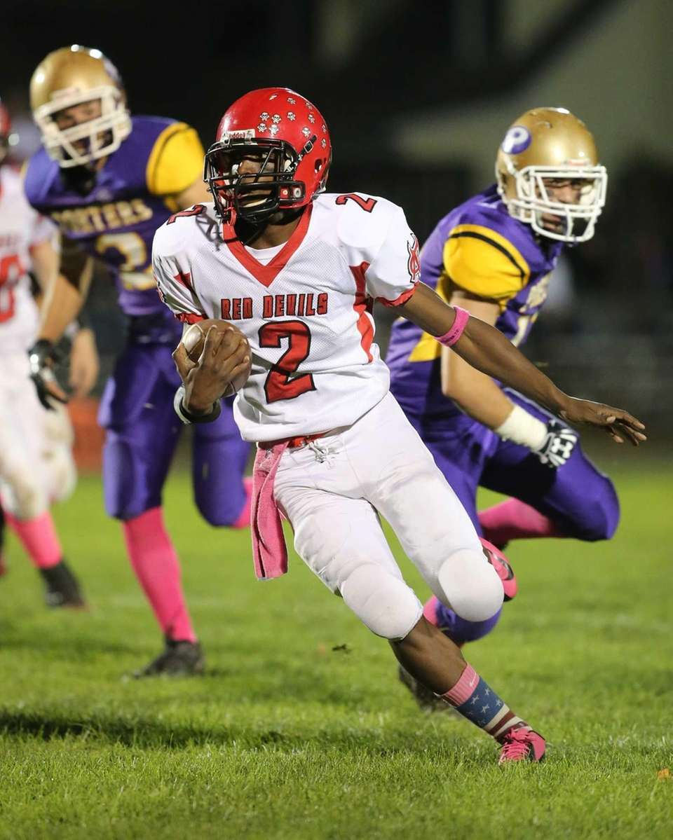 Center Moriches Tarik Rountree returns a punt in